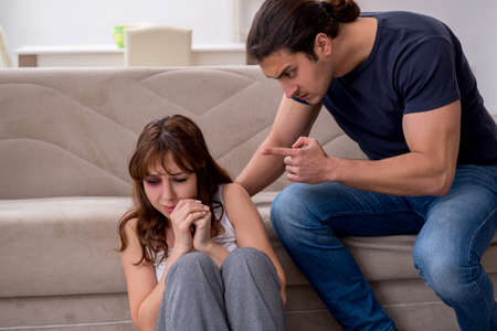 Young couple in domestic violence concept