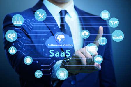 Software as a service - SaaS concept with businessman Banco de Imagens