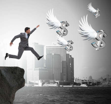 The businessman chasing angel dollars in business concept