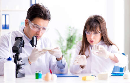 Two lab doctor testing food products Standard-Bild