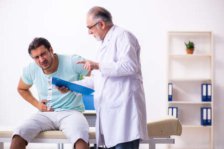 Young male patient visiting experienced doctor