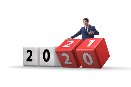 Businessman turning the year from 2020 to 2021