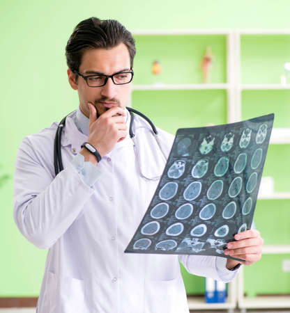 Doctor radiologist looking at x-ray scan in hospital