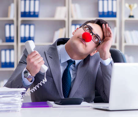 Clown businessman angry frustrated working in the office