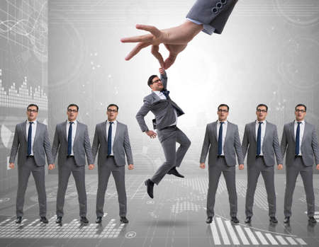 Recruitment concept with hand picking employee Фото со стока