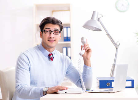Businessman employee talking on the office phone Stock fotó