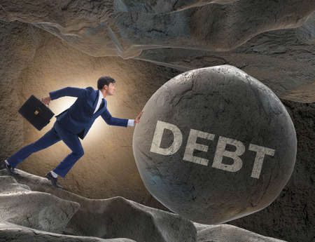 The businessman in high interest debt business concept