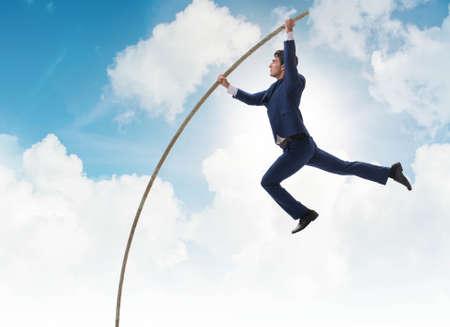 Businessman in pole vaulting concept Standard-Bild