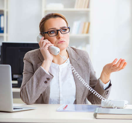 Businesswoman employee talking on the office phone Stock fotó