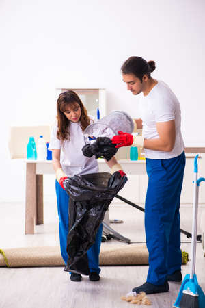Young pair doing housework at home
