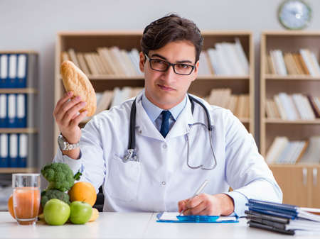 Scientist studying nutrition in various food Stock Photo