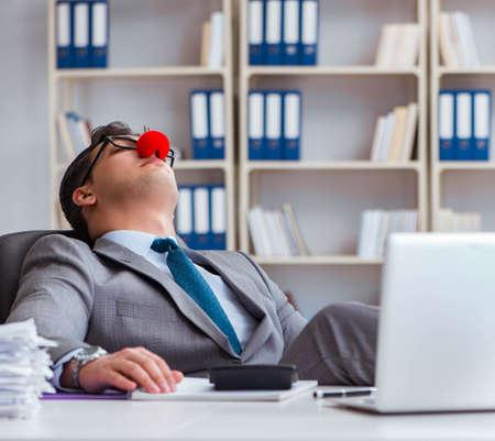Clown businessman tired sleepy in the office
