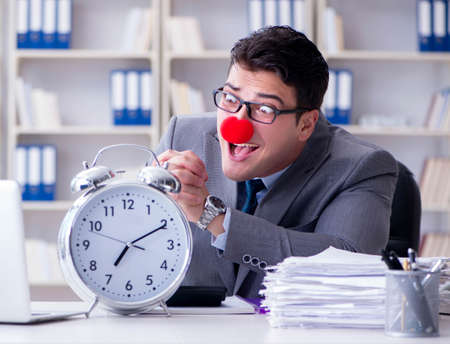The clown businessman with alarm clock missing dieadline