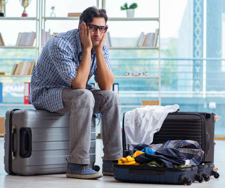 Young man preparing for vacation travel