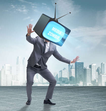Media zombie concept with man and tv set instead of head