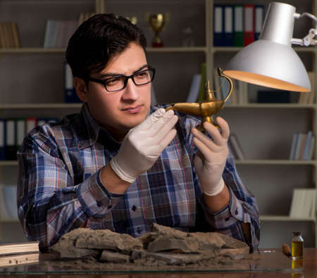 Archeologist working late night in office