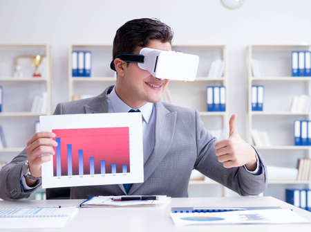 Businessman with virtual reality glasses in the office Stock fotó