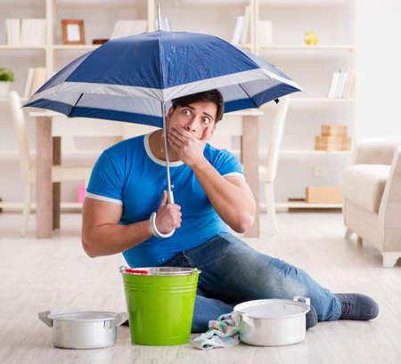 Man at home dealing with neighbor flood leak Reklamní fotografie