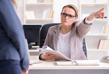 Angry boss dismissing employee for bad underperformance Stock fotó