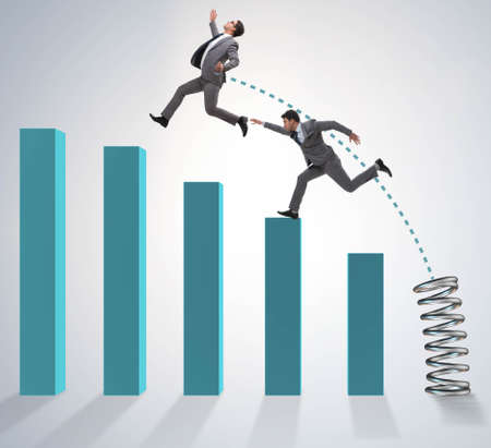 Business people jumping over bar charts Stockfoto