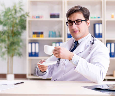 Young doctor sitting in the office Stok Fotoğraf