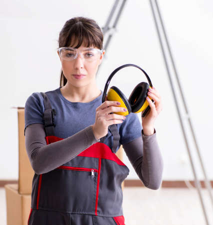 Woman contractor worker with noise cancelling headphones Reklamní fotografie
