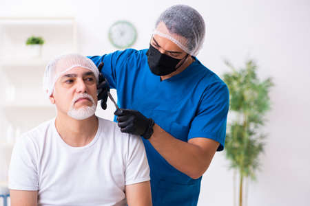 Old man visiting male doctor for plastic surgery