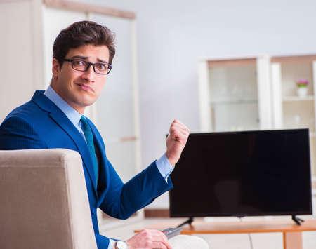 Businesman watching tv in office Stockfoto