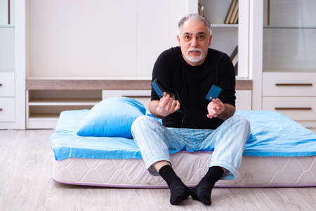 Old man running out of money in the bedroom
