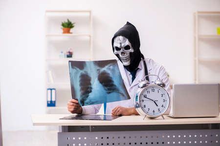 Male devil doctor radiologist working in the clinic 写真素材