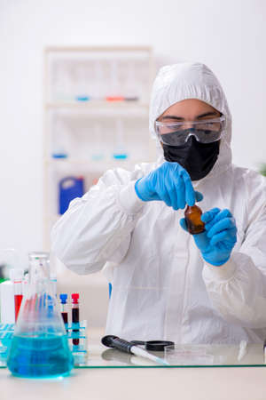 Young male chemist working in medicine lab Stock fotó