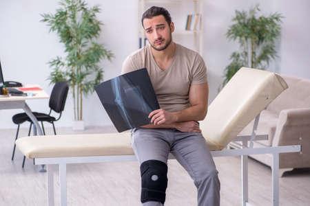 Young leg injured man looking x-ray