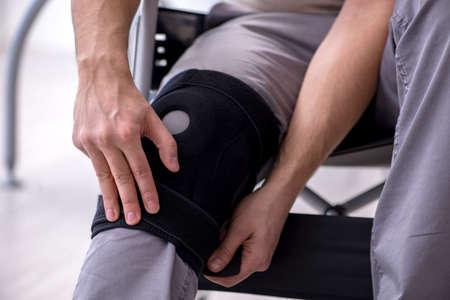 Young leg injured man in wheel-chair