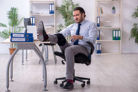 Young leg injured employee working in the office Stock fotó