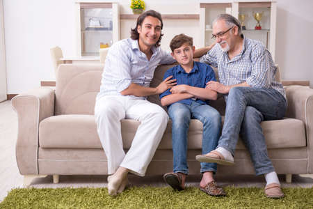Boy and his father and his grandfother indoor Banco de Imagens