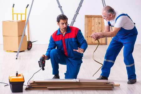 Two contractors and snake indoors Banco de Imagens