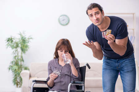 Disabled wife and young husband at home Stock fotó
