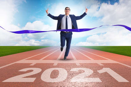 Businessman on finish line to year 2021