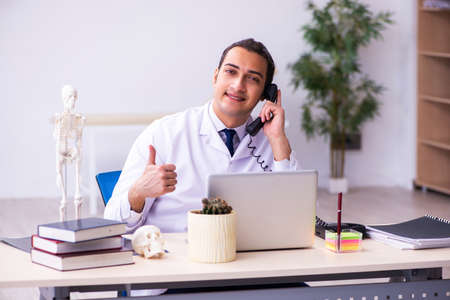 Young male doctor working in the clinic 免版税图像