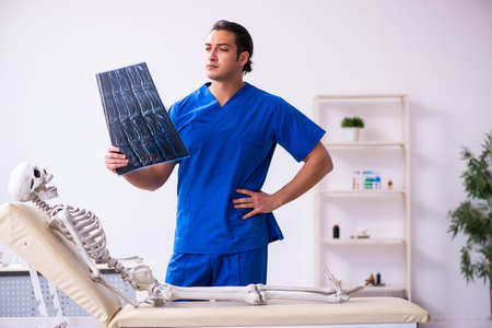 Young male radiologist doctor and skeleton patient