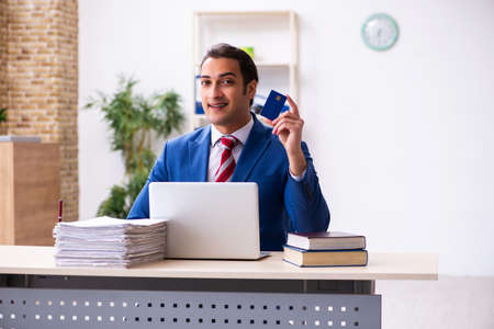 Young male employee working in the office