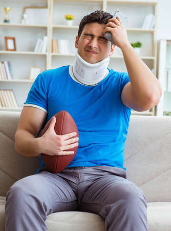 Man with neck injury watching american football at home