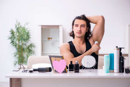 Young handsome man preparing for date