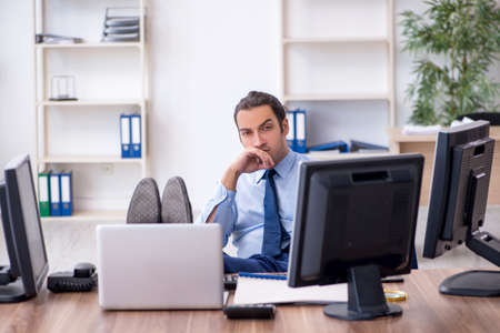 Young male employee working in the office Stock Photo