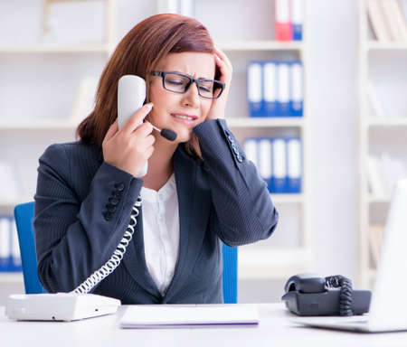 The frustrated call center assistant responding to calls Standard-Bild