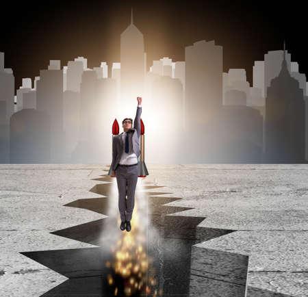Businessman flying on rocket from rock gap Imagens