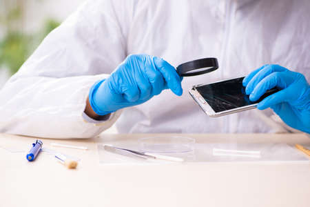 Male expert criminologist working in the lab for evidence