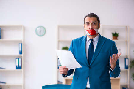 Mouth closed male employee working in the office