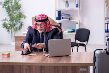 Old arab businessman in the office