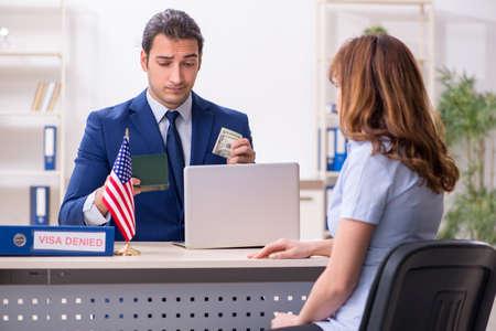 Young woman visiting american embassy for visa